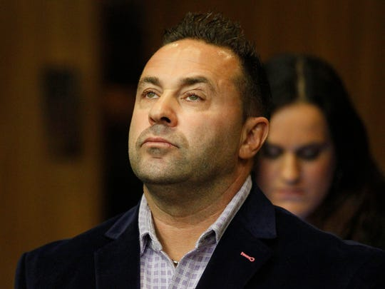 In this Oct. 15, 2014 file photo, Joe Giudice stands during a hearing in the Passaic County Courthouse in Paterson, N.J.