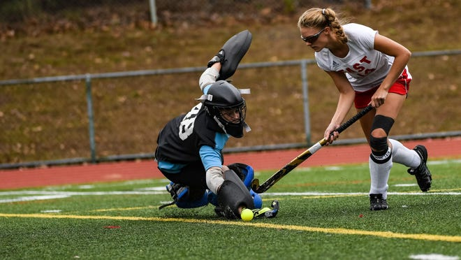 Pocono Mountain East's Gaby Bullis gets past the Liberty goalie for a score in flick offs during the Eastern Pennsylvania Conference field hockey playoffs in Swiftwater on Saturday, October 12, 2019. The Cardinals fell in the shootout 4-3.