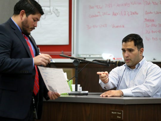 Anthony Molina views text and Facebook messages from District Attorney Mark Gonzalez during his trial on Wednesday, Feb.16, 2017, at the 214th District Court in Corpus Christi.