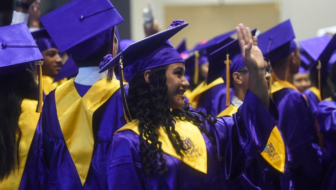 In this June 1 file photo, graduates wave to their supporters during the George Washington High School Class of 2018 Graduation Exercise at the University of Guam Calvo Field House.