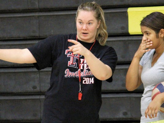 Alamogordo head coach Savannah Stockton, left, instructs Megan Sampath during workouts Monday at the Tiger Pit.