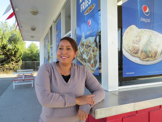 In this file photo, Dulce Yebra poses on the patio at B&J Drive-In in Saticoy.