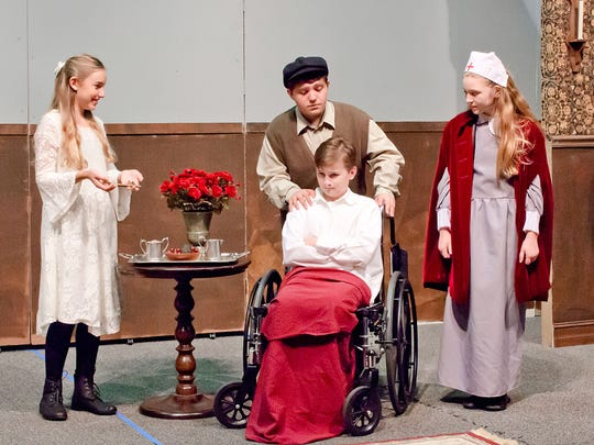 "A scene from the CFABS Youth Theater's production of ""The Secret Garden."" From left to right: Kristen Noble, Gianni Gizzi, Michael Cherbini (seated) and Brie Shrawder."