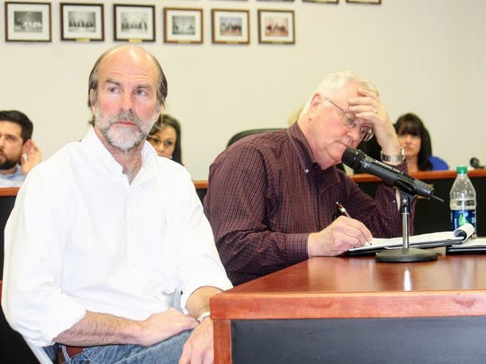 In this file photo, Program Manager and Senior Geologist Peter Gram, left, and TerranearPMC C.E.O. Kenneth T. Fillman, right, discuss the Salt Basin Deep Borehole Research Project at the Feb. 9 regular county commission meeting.
