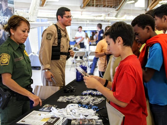 In this file photo, Members of the U.S. Customs and Border Patrol provide information to students about their career at Holloman Air Force Base at the 2016 Aviation Aerospace STEM Expo.