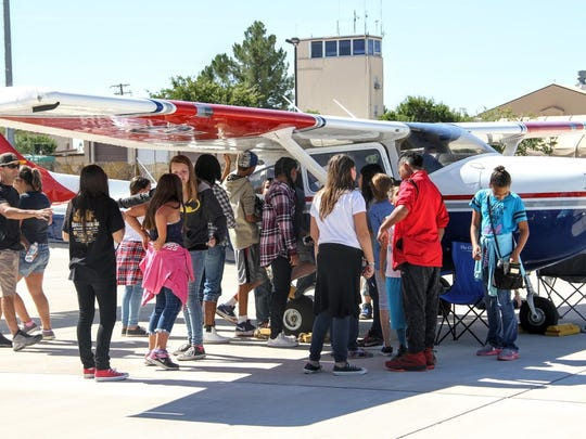 In this file photo, students stand next to a small plane at Holloman Air Force Base to learn about different aviation aircraft at the 2016 Aviation Aerospace STEM Expo.