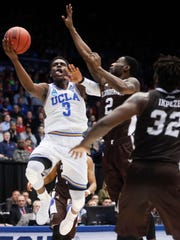 UCLA's Aaron Holiday (3) shoots against St. Bonaventure's Matt Mobley (2) during the first half of a First Four game of the NCAA men's college basketball tournament, Tuesday, March 13, 2018, in Dayton, Ohio. (AP Photo/John Minchillo)