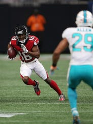 Atlanta Falcons wide receiver Taylor Gabriel (18) runs