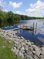 John Taylor and Dave Porter purchased the land abutting Upper Spring Lake near Palmyra, Wis., for its seclusion and rebuilt the dam that created the lake when the dam washed out.