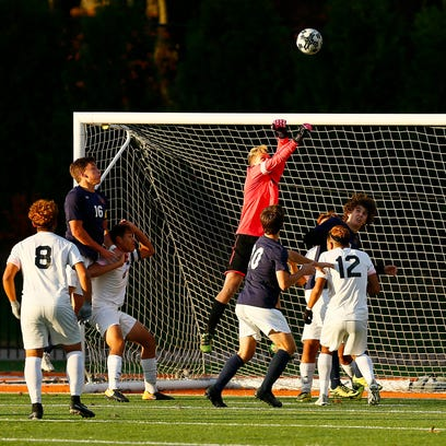 Dover goalkeeper David Hoyt goes up for a save on a