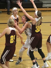 Indianola sophomore Grace Berg tries to fight her way to the basket. Class 5-A fifth-ranked Indianola beat Ankeny 52-47 in Indianola on Dec. 15.