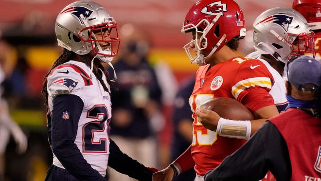 New England Patriots cornerback Stephon Gilmore, left, talks with Kansas City Chiefs quarterback Patrick Mahomes after an NFL football game, Monday, Oct. 5, 2020, in Kansas City. The Chiefs won 26-10. Sports Illustrated reported Gilmore tested positive for COVID-19 on Wednesday.
