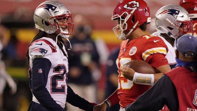 New England Patriots cornerback Stephon Gilmore, left, talks with Kansas City Chiefs quarterback Patrick Mahomes after Monday's game in Kansas City. The Chiefs won 26-10. On Wednesday, Gilmore tested positive for COVID-19 and was placed on the team's COVID-19/Reserve list.