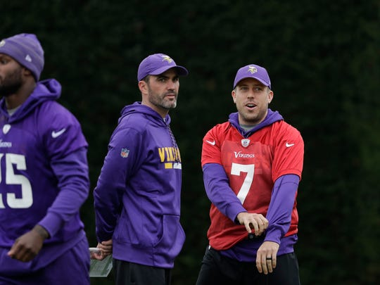 Minnesota Vikings quarterback Case Keenum talks to quarterbacks coach Kevin Stefanski during an NFL walkthrough practice session at Syon House in Syon Park, south west London, Thursday, Oct. 26, 2017. The Minnesota Vikings are preparing for an NFL regular season game against the Cleveland Browns in London on Sunday. (AP Photo/Matt Dunham)