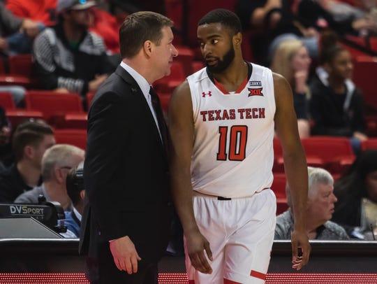 Texas Tech head coach Chris Beard talks with guard