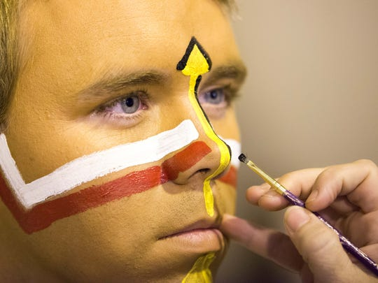 Student, Brendan Carter, is made up before he depicts Osceola at FSU's game vs. Miami.