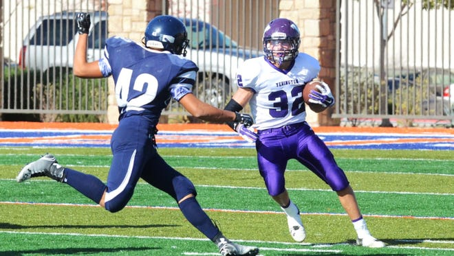 YHS' Reese Neville, here carrying the ball in the state championship game Nov. 22 against Meadows, was named the state and northern region football MVP for Division III.