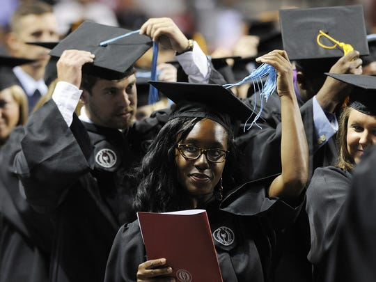 Graduates move their tassels from right to left as their graduation is confirmed at the Troy University Spring Commencement Exercises in Troy on May 8, 2015. Troy University's Montgomery campus is located in downtown Montgomery and includes unique facilities like the Rosa Parks Library and Museum, the Davis Theatre for Performing Arts and WA Gale Planetarium.