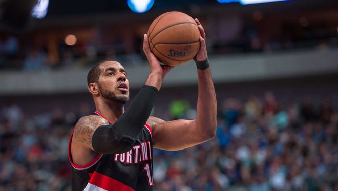 Apr 15, 2015: Portland Trail Blazers forward LaMarcus Aldridge (12) shoots a free throw during the game against the Dallas Mavericks at the American Airlines Center. The Mavericks defeated the Trail Blazers 114-98.