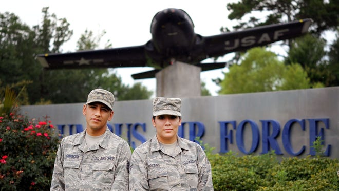 Staff Sgt. Luis Chiriboga, a 14th Civil Engineer Squadron engineering technician, and his wife, Airman 1st Class Estefania Briceno Ron, a personnel and administration technician assigned to the 14th Medical Support Squadron, stand at the entrance of Columbus Air Force Base, Miss. Chiriboga and Briceno Ron are both natives of Ecuador and received their U.S. citizenship after joining the Air Force.
