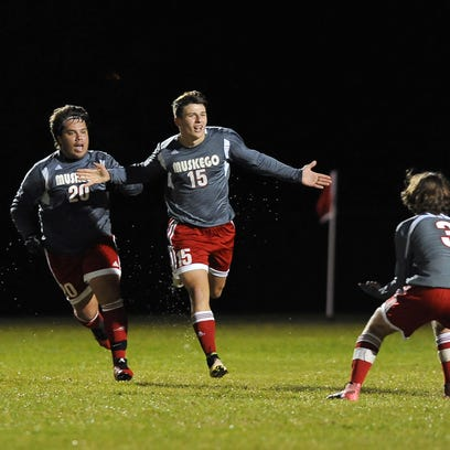 Muskego forward Rade Novakovich, center celebrates his goal in the first half against Oak Creek during the WIAA boys soccer sectional semifinal at Oak Creek at Oak Creek East Middle School Thursday, Oct. 27.