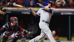 Chicago Cubs player Kyle Schwarber hits a double against