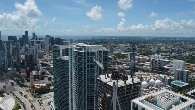 The Miami skyline is seen in this aerial view with cranes, Thursday, Sept. 7, 2017, in Miami. As Hurricane Irma threatens to pound Miami with winds of mind-boggling power, a heavyweight hazard looms over the city's skyline: two dozen enormous construction cranes.