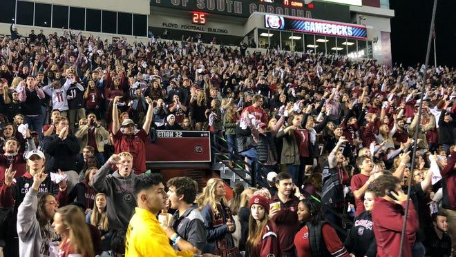 South Carolina fans yell at Clemson players during pregame warmups at Williams-Brice Stadium on November 25, 2017.