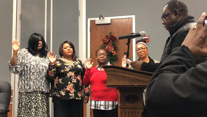 From left: Lisa Kennedy, Tonya Thompson-Morgan, board president Margie Orr and Tanoue Sweeney take their oath to serve on the York City school board on Wednesday, Dec. 6, 2018.