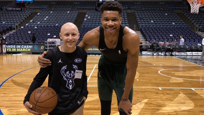 Milwaukee Bucks star Giannis Antetokounmpo poses for a photo with Matthew Ceelen, a Milwaukee teen fighting bone cancer.