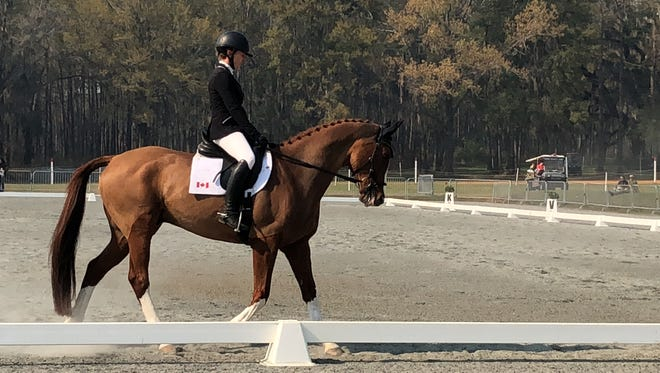 Canadian rider Jessica Phoenix rides during one of six dressage tests Friday at Elinor Klapp-Phipps park during the 20th annual Red Hills Horse Trials.