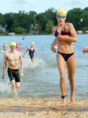 Alysa Wager, 14, of Harper Creek finishes first amongst females in the 1.15 mile race at Goguac Lake during the YMCA Goguac Lake Swim in 2016.