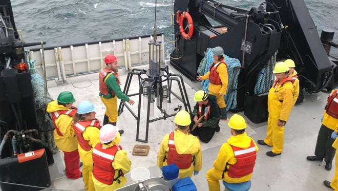 A team of teachers and scientists sends a multi-core processor into Lake Michigan to collect samples.