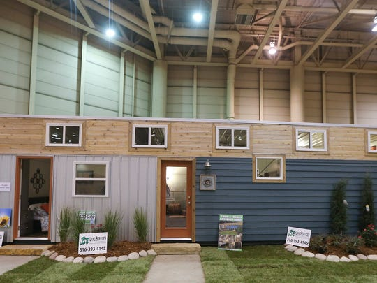 Custom Container Living buys used steel shipping containers for $2,000 to $3,000 and turns them into homes it sells for $40,000 to more than $60,000. The tiny home was on display at the Wichita Home Remodeling & Decorating Expo.