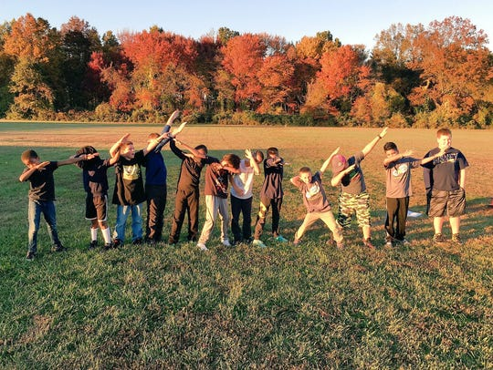 Carrie Downie Elementary School's Let Me Run team poses