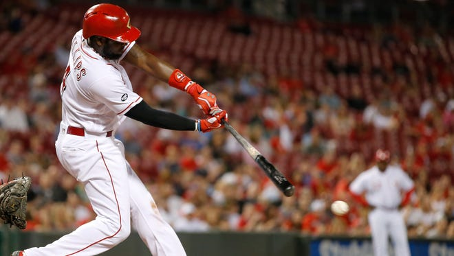 Cincinnati Reds second baseman Brandon Phillips (4) singles in the eighth inning during the MLB game between the Colorado Rockies and the Cincinnati Reds, Tuesday, April 19, 2016, at Great American Ball Park in Cincinnati.