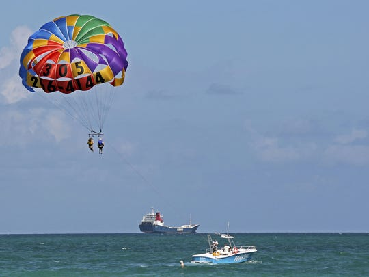Indulge your adventurous side with parasailing.   Looking to get a bit of a thrill out of your day at the beach? Try soaring 500 feet above the surf.