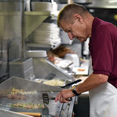 Jim's Lunch owner Jim Maul prepares breakfast on Monday.