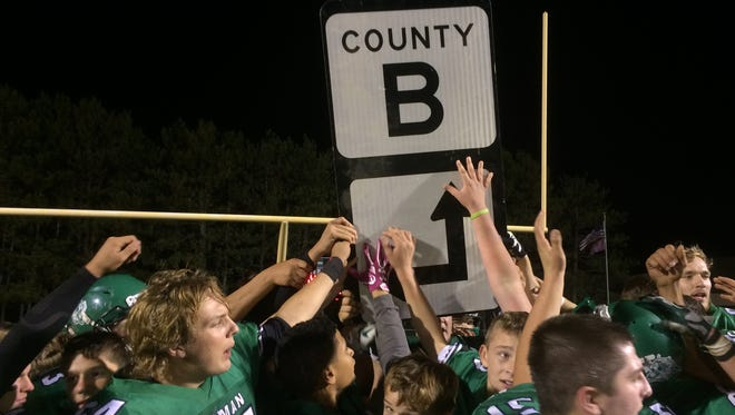 The Coleman football team celebrates its 14-9 victory over Peshtigo on Oct. 14 in the Battle for County Road B game.