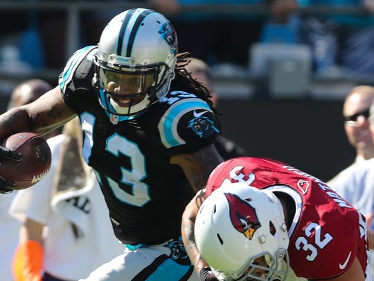 Carolina Panthers wide receiver Kelvin Benjamin tries