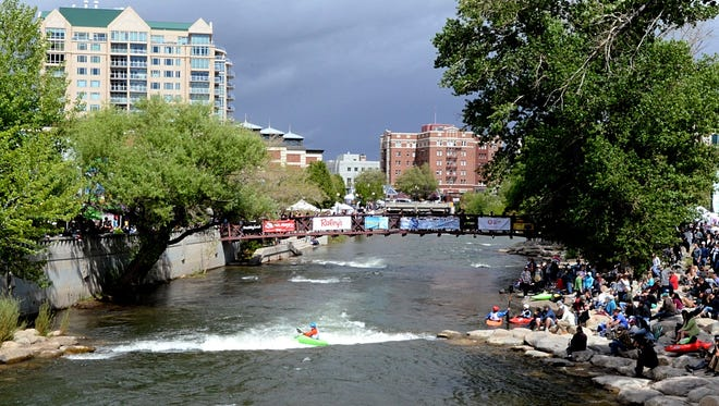Images from the annual Reno River Festival showing a man on the Truckee River on May 12, 2018.