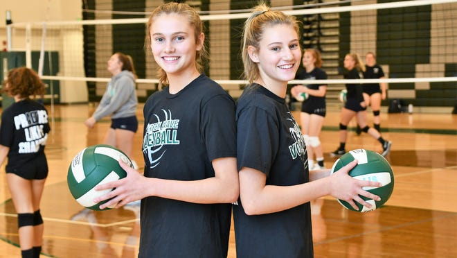 The Vitko sisters, Tory, left, and Rachel, have played a major role in Dover High School's 6-0 start this season in Division I volleyball.