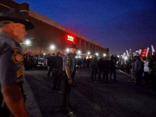 Police stand in the middle of a driveway dividing Donald Trump supporters, left, and protesters, right, after a rally for the Republican presidential candidate Thursday, April 21, 2016, outside the Pennsylvania Farm Show Complex in Harrisburg. The Pennsylvania presidential primary is April 26.