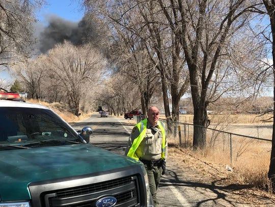 San Juan County deputy sets up a road block near the