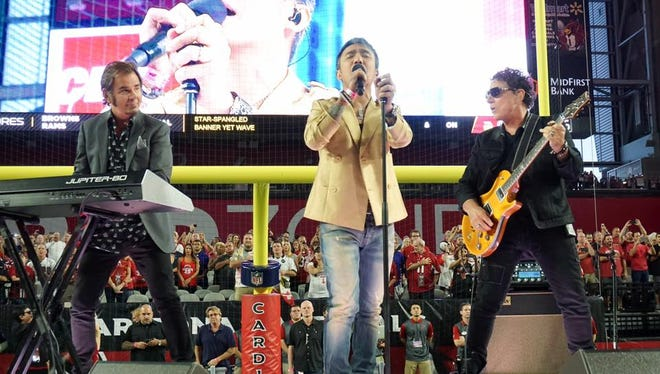 Journey performed the national anthem at an Arizona Cardinals football game in 2015.