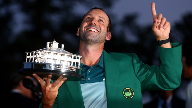 Sergio Garcia celebrates with the trophy after winning a one hole playoff with Justin Rose at The Masters golf tournament at Augusta National GC, Apr. 9, 2017.