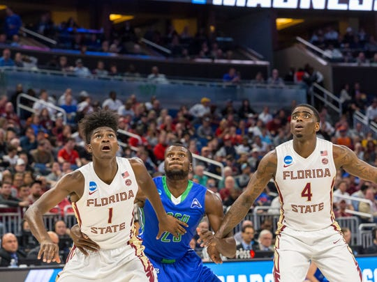 Florida State guard Dwayne Bacon (4) and forward Jonathan Isaac (1) box-out Florida Gulf Coast forward Marc-Eddy Norelia during the first round of the NCAA Tournament at the Amway Center on Thursday night.