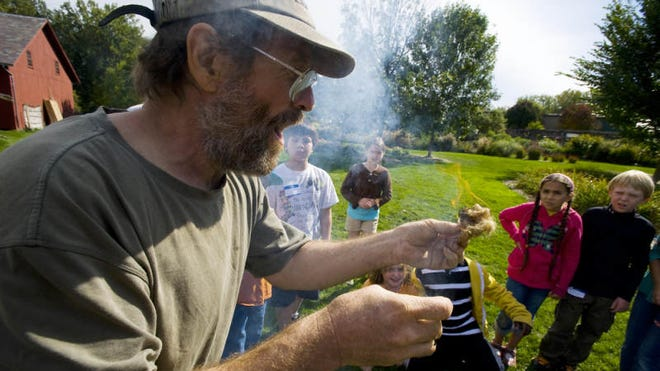 Archeologist Charles Paquin demonstrates how native peoples made fire as students from the Champlain School in Burlington explore the Abenaki Heritage Garden in the Intervale as part of the Heritage Harvest Celebration in Burlington on Thursday, September 23, 2010.