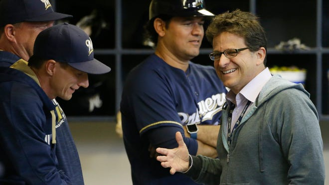 Brewers Mark Attanasio has been thinking about the Brewers' playoff hopes.