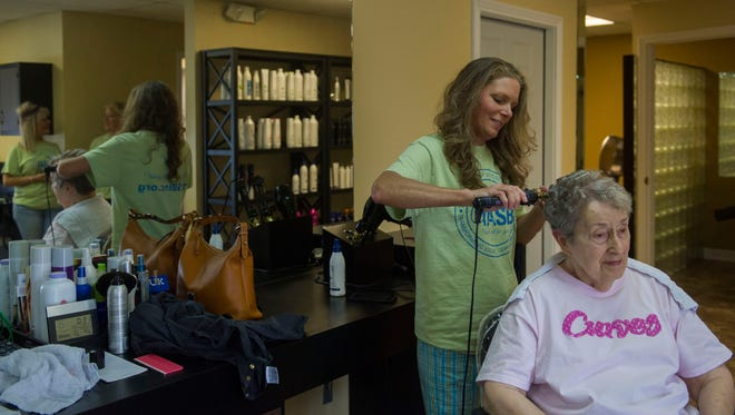 Stylist Andi Adkins from Salon 421 curls Bettie Christofoli's hair. The woman has been a regular at the salon since she moved to Henderson from Chicago in 1998.